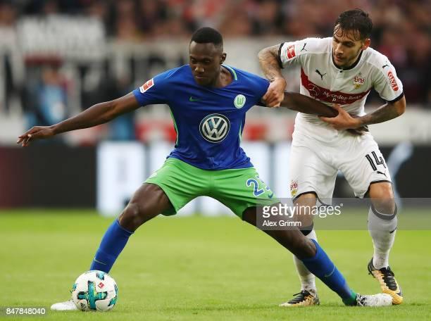 Josuha Guilavogui of Wolfsburg fights for the ball with Anastasios Donis of Stuttgart during the Bundesliga match between VfB Stuttgart and VfL...
