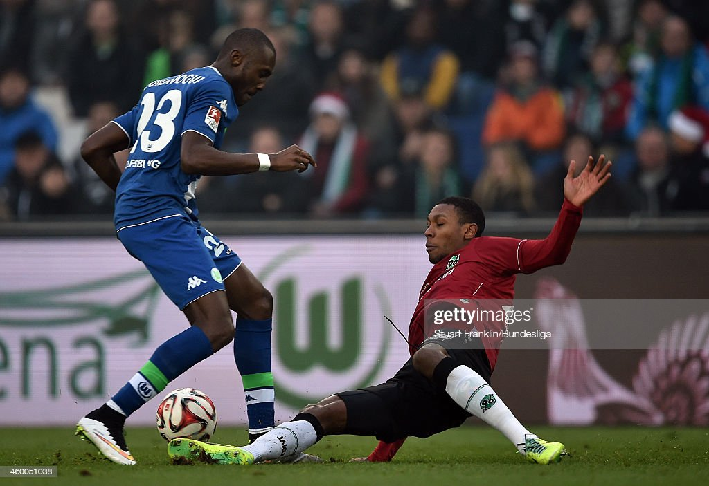 Josuha Guilavogui of Wolfsburg is challenged by Marcelo Guedes of Hannover during the Bundesliga match between Hannover 96 and VfL Wolfsburg at HDI-Arena on December 6, 2014 in Hanover, Germany.