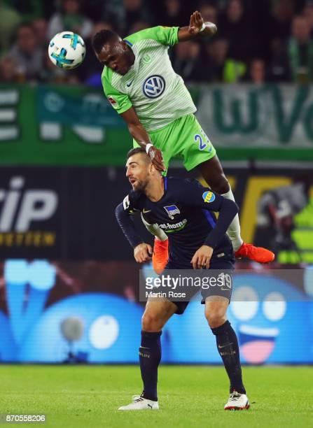 Josuha Guilavogui of Wolfsburg outjumps Vedad Ibisevic of Berlin during the Bundesliga match between VfL Wolfsburg and Hertha BSC at Volkswagen Arena...