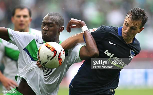 Josuha Guilavogui of Wolfsburg vies with Vladimir Darida of Berlin during the Bundesliga match between VfL Wolfsburg and Hertha BSC at Volkswagen...