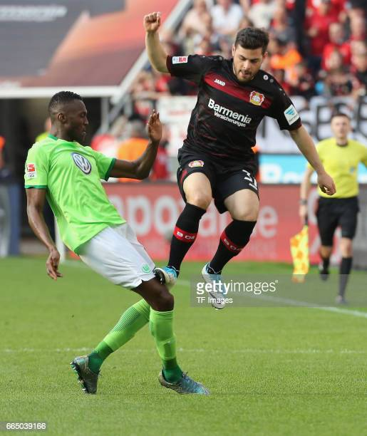 Josuha Guilavoqui of Wolfsburg and Kevin Volland of Leverkusen battle for the ball during the Bundesliga match between Bayer 04 Leverkusen and VfL...