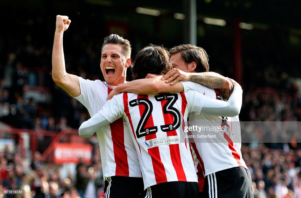 Jota of Brentford celebrates scoring the second Brentford goal with Sergi Canos during the Sky Bet Championship match between Brentford and QPR at Griffin Park on April 22, 2017 in Brentford, England.