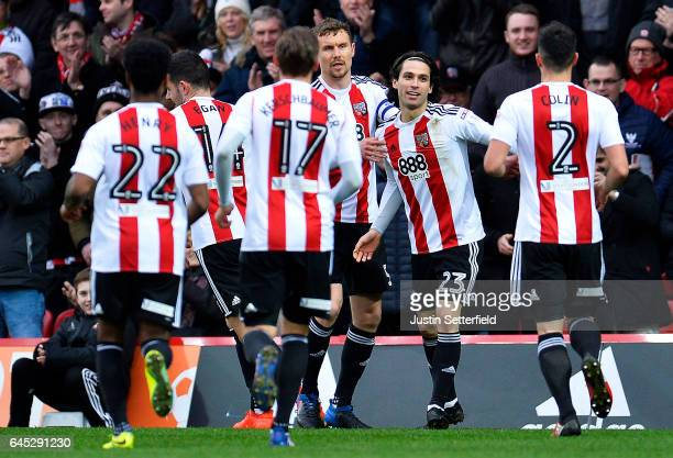 Jota of Brentford FC celebrates scoring the first Brentford goal during the Sky Bet Championship match between Brentford and Rotherham at Griffin...