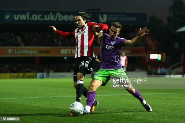 Jota of Brentford is tackled by Joe Bryan of Bristol City during the Sky Bet Championship match between Brentford and Bristol City at Griffin Park on...