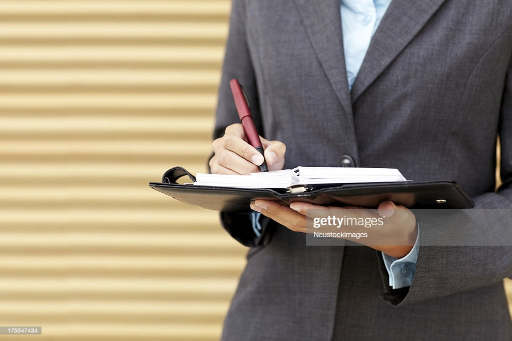 Jotting Down Business Schedule : Stock Photo