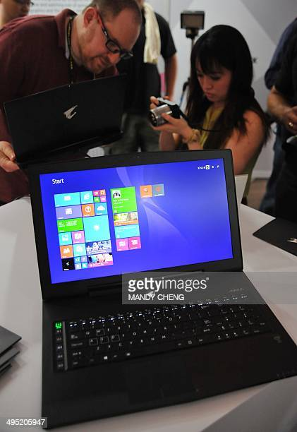 Jounalists look at new products during a preshow press conference ahead of the Computex trade fair in Taipei on June 2 2014 Asia's largest tech trade...