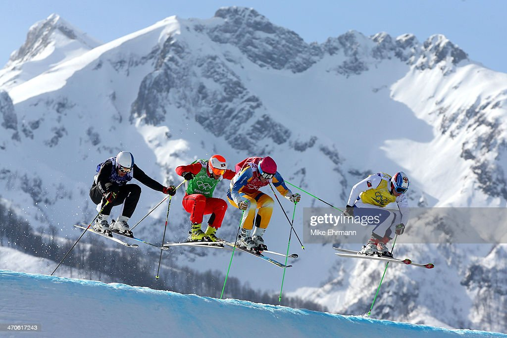 Jouni Pellinen of Finland, Armin Niederer of Switzerland, Victor Oehling Norberg of Sweden and Egor Korotkov of Russia compete during the Freestyle Skiing Men's Ski Cross Quarter Finals on day 13 of the 2014 Sochi Winter Olympic at Rosa Khutor Extreme Park on February 20, 2014 in Sochi, Russia.