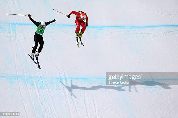 Jouni Pellinen of Finland leads from Armin Niederer of Switzerland during the Freestyle Skiing Men's Ski Cross 1/8 Finals on day 13 of the 2014 Sochi...