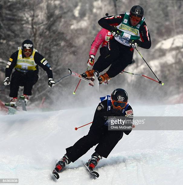 Jouni Pellinen of Finland leads through a turn in front of Davey Barr of Canada Errol Kerr of Jamaica and Jakub Fiala of the USA during the Men's Ski...