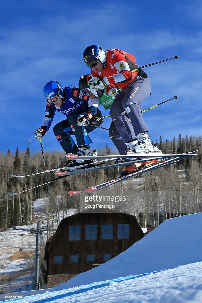 Jouni Pellinen of Finland, Mathieu Leduc of Canada and David Duncan of Canada battle for position during their eighth final heat in the Audi FIS Ski Cross World Cup on December 12, 2012 in Telluride, Colorado.