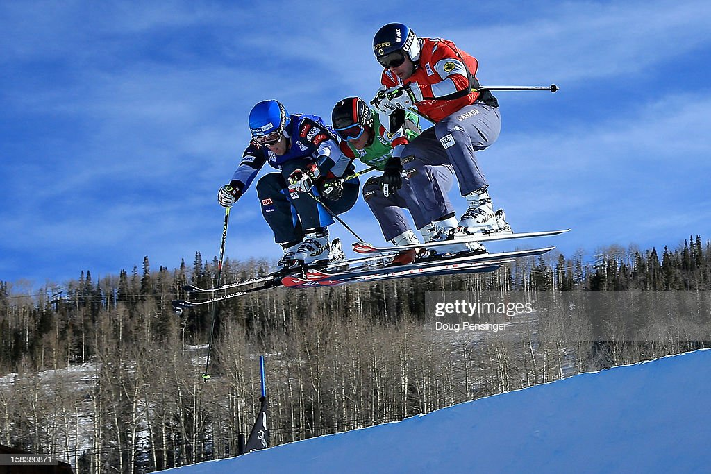 Jouni Pellinen of Finland, Mathieu Leduc of Canada and David Duncan of Canada battle for position during their eighth final heat in the Audi FIS Ski Cross World Cup on December 13, 2012 in Telluride, Colorado.