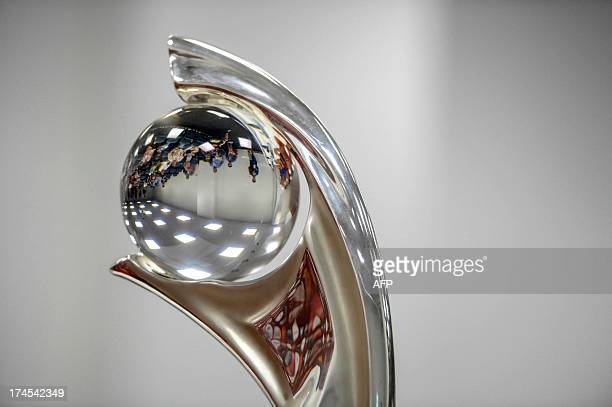 Jourbalists are reflected inthe Euro trophy during a press conference of team Norway in Stockholm on July 27 2013 on the eve of the UEFA Women's EURO...
