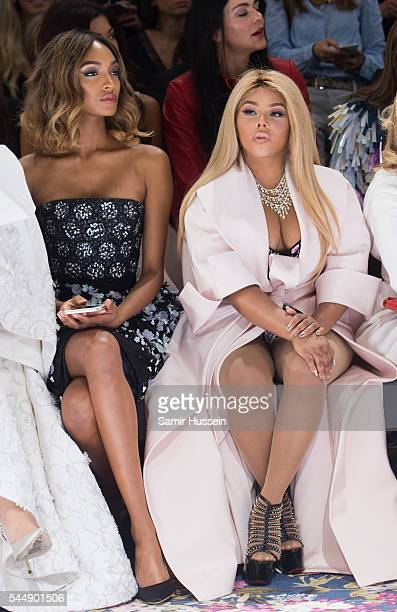 Jourdan Dunn and Lil' Kim attend the Ralph Russo Haute Couture Fall/Winter 20162017 show as part of Paris Fashion Week on July 4 2016 in Paris France