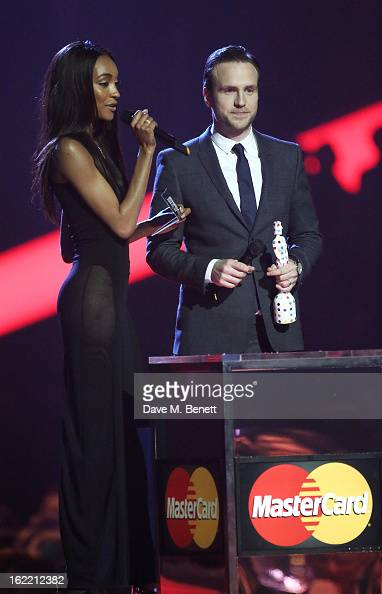 Jourdan Dunn and Rafe Spall present on stage at the Brit Awards at 02 Arena on February 20 2013 in London England