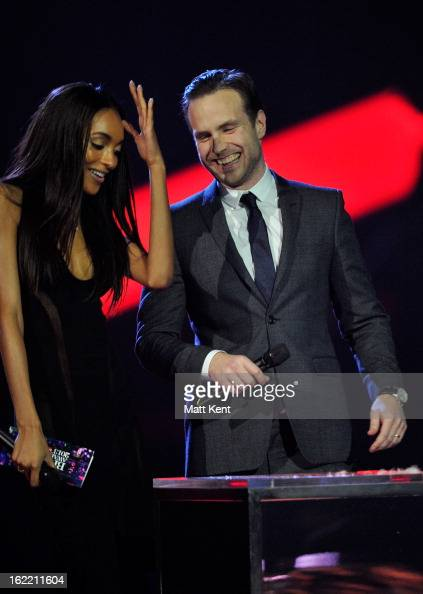 Jourdan Dunn and Rafe Spall present the award for Best International Male Solo Artist on stage during the Brit Awards 2013 at the 02 Arena on...