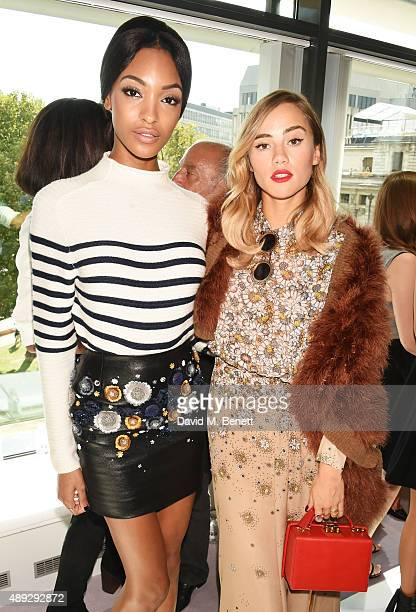 Jourdan Dunn and Suki Waterhouse attend the Topshop Unique show during London Fashion Week SS16 at The Queen Elizabeth II Conference Centre on...