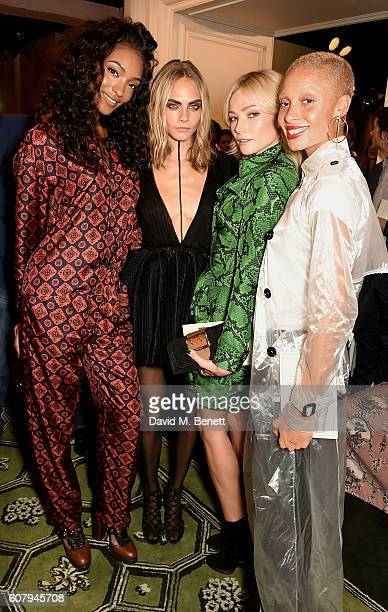 Jourdan Dunn Cara Delevingne Clara Paget and Adwoa Aboah wearing Burberry at the Burberry September 2016 show during London Fashion Week SS17 at...