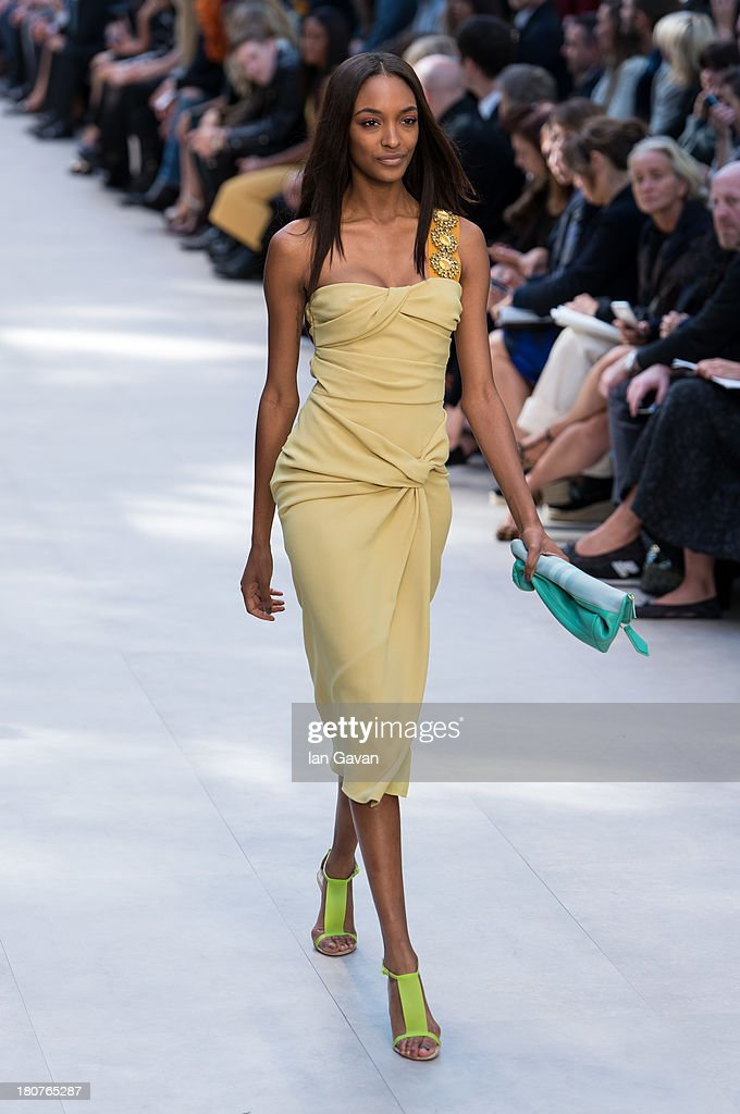 Jourdan Dunn walks the runway at the Burberry Prorsum show at London Fashion Week SS14 at Kensington Gardens on September 16, 2013 in London, England.