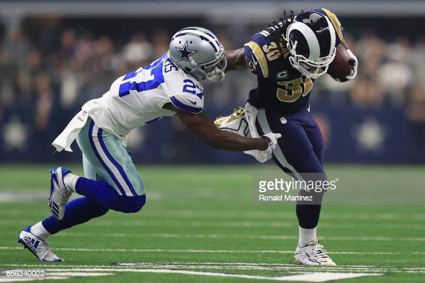 Jourdan Lewis of the Dallas Cowboys pursues Todd Gurley of the Los Angeles Rams in the first half of a game at ATT Stadium on October 1 2017 in...