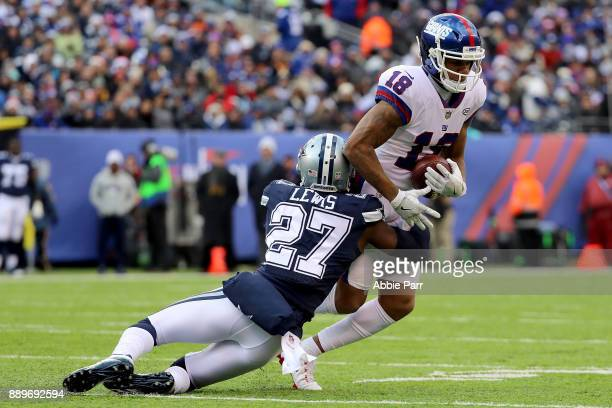 Jourdan Lewis of the Dallas Cowboys tackles Roger Lewis of the New York Giants in the second half during their game at MetLife Stadium on December 10...