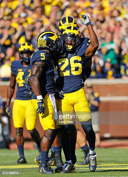 Jourdan Lewis of the Michigan Wolverines celebrates with his teammates after making a fourth down stop during the second quarter of the game against...