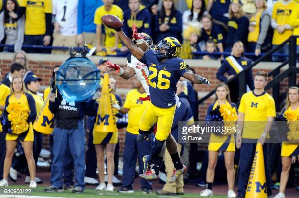 Jourdan Lewis of the Michigan Wolverines defends a pass against DJ Moore of the Maryland Terrapins at Michigan Stadium on November 5 2016 in Ann...