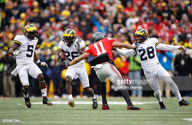 Jourdan Lewis of the Michigan Wolverines returns a kickoff at the end of the fourth quarter against the Ohio State Buckeyes at Ohio Stadium on...