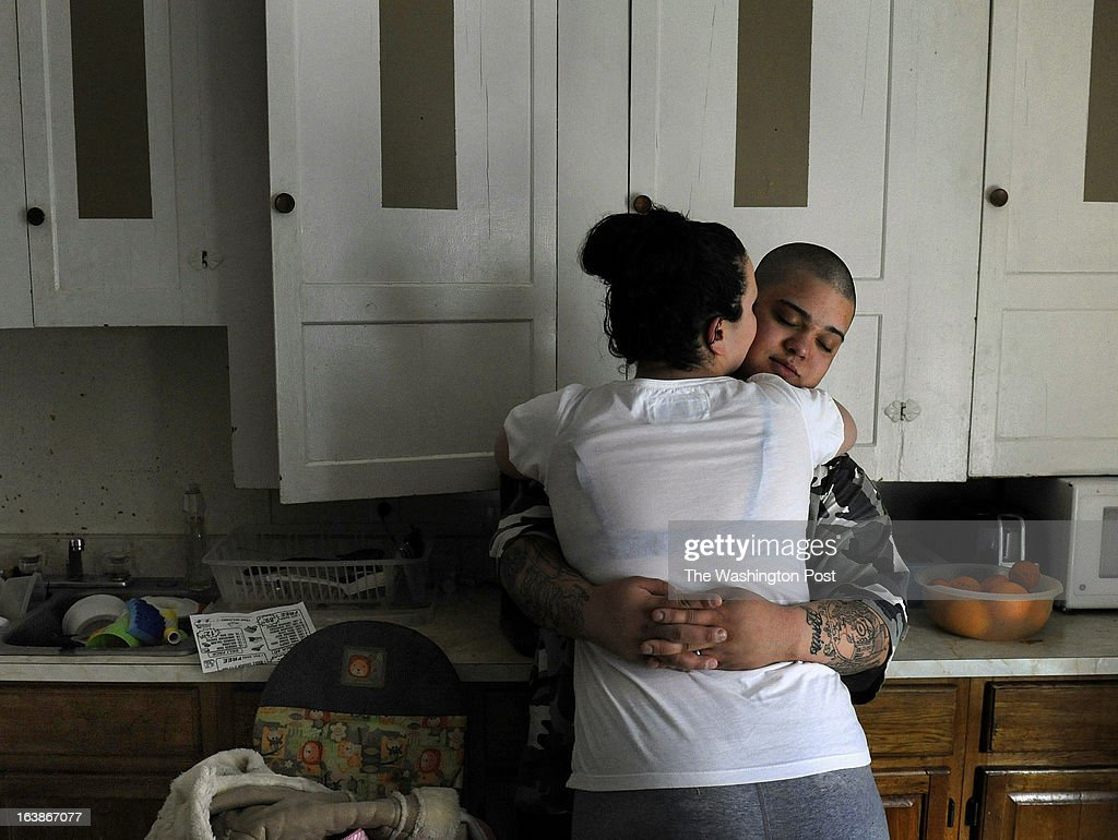 Jourie Ortiz gets some attention from his wife Rebecka after he was woozy and hardly able to stand after going 48 hours with only about 5 hours of sleep. He works an overnight shift but then comes home to be with his family and only gets 2 and 1/2 hours of sleep on many days. Many families and individuals in Woonsocket, Rhode Island are needy and take part in the SNAP (food stamps) program. Photo by Michael S. Williamson/The Washington Post via Getty Images