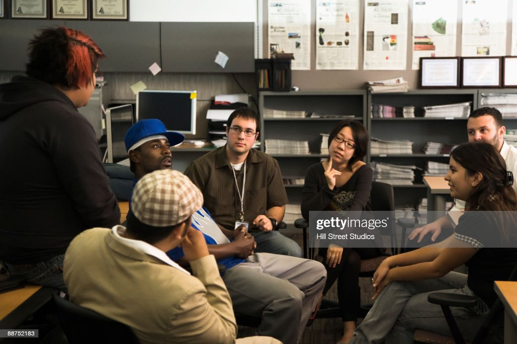 Journalism students sitting in a circle : Stock Photo
