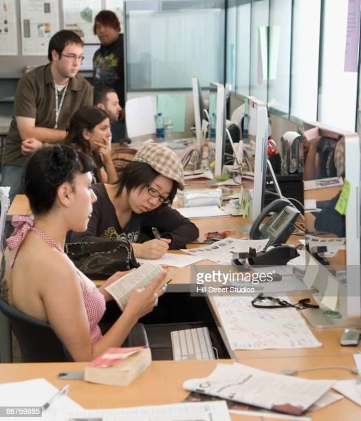 Journalism students working in classroom