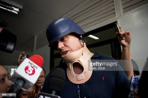 ABC journalist Adam Harvey wears a neckbrace as he is about to ride an ambulance at the Lanao Del Sur Provincial Capitol in Marawi on the southern...