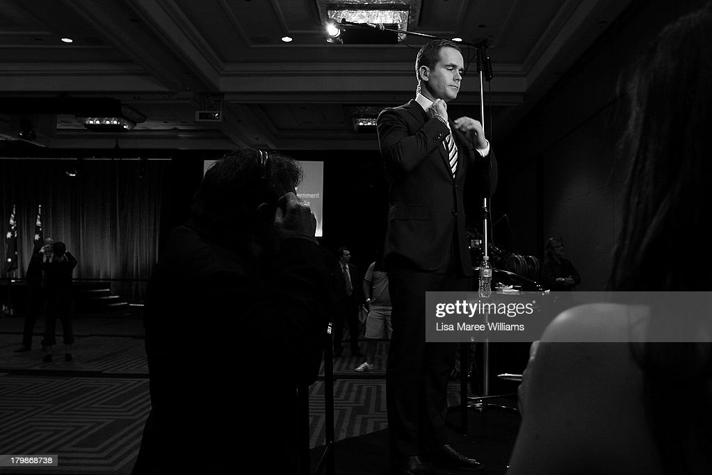 A journalist adjusts his tie during the Liberal Party Election function on September 7, 2013 in Sydney, Australia. Liberal-National Coalition leader Tony Abbott was elected Prime Minister in a landslide victory over Labor leader Kevin Rudd, bringing the conservative party to power for the first time in six years.
