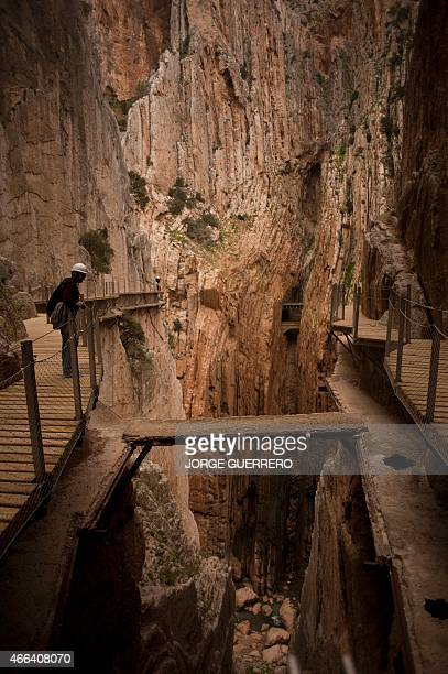 A journalist admires the scenery during a visit to the footpath 'El Caminito del Rey' a narrow walkway hanging and carved on the steep walls of a...