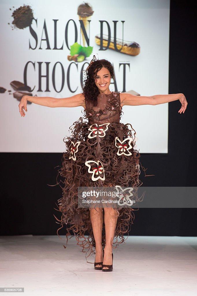 Journalist Aida Touihri walks the runway and wears 'L'Alchimie de la Nature' a chocolate dress made by designer Lauren Bitar and chocolate maker Arnaud Larher during the Fashion Chocolate Show at Salon du Chocolat at Porte de Versailles, in Paris.