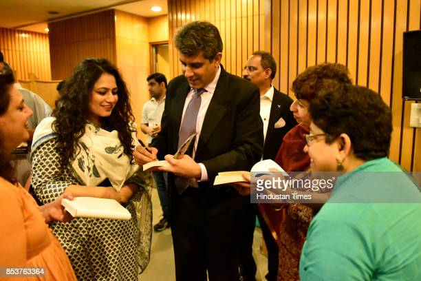 Journalist and author Rahul Singh signs the copy of book 'India's Most Fearless' during its launch ceremony on September 25 2017 in New Delhi India...