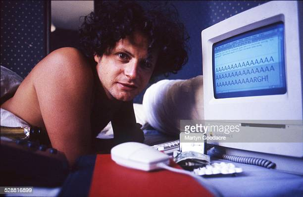 Journalist and editor James Brown lies in bed with an Apple Macintosh computer London United Kingdom 1997 Brown cofounded the magazine Loaded in 1994