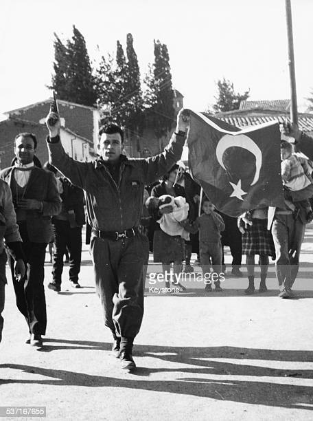 Journalist and EOKA member Nicos Sampson celebrating with his platoon as he returns with captured Turkish flags January 14th 1964