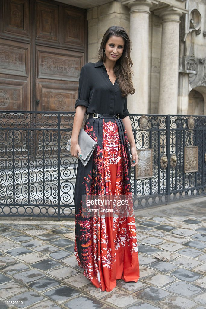 Journalist and former Miss France <a gi-track='captionPersonalityLinkClicked' href=/galleries/search?phrase=Malika+Menard&family=editorial&specificpeople=6567815 ng-click='$event.stopPropagation()'>Malika Menard</a> wearing a Stella McCartney bag and Zuhair Murad skirt and shirt day 5 of Paris Haute Couture Fashion Week Autumn/Winter 2014, on July 10, 2014 in Paris, France.