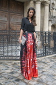 Journalist and former Miss France Malika Menard wearing a Stella McCartney bag and Zuhair Murad skirt and shirt day 5 of Paris Haute Couture Fashion...