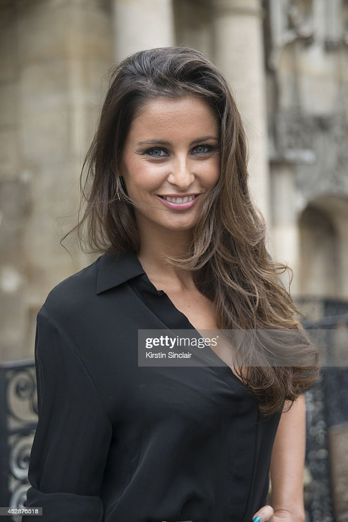 Journalist and former Miss France <a gi-track='captionPersonalityLinkClicked' href=/galleries/search?phrase=Malika+Menard&family=editorial&specificpeople=6567815 ng-click='$event.stopPropagation()'>Malika Menard</a> wearing a Zuhair Murad skirt day 5 of Paris Haute Couture Fashion Week Autumn/Winter 2014, on July 10, 2014 in Paris, France.
