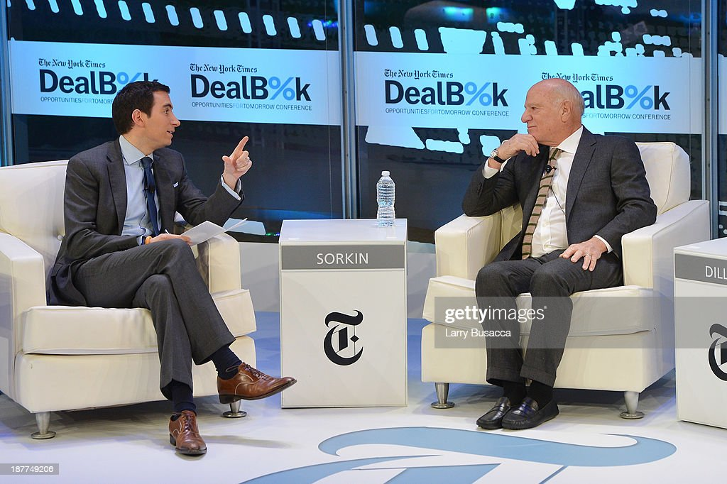 Journalist Andrew Ross Sorkin (L) and Chairman and Senior Executive at IAC Barry Diller participate in a discussion at the New York Times DealBook Conference at New York Times Building on November 12, 2013 in New York City.