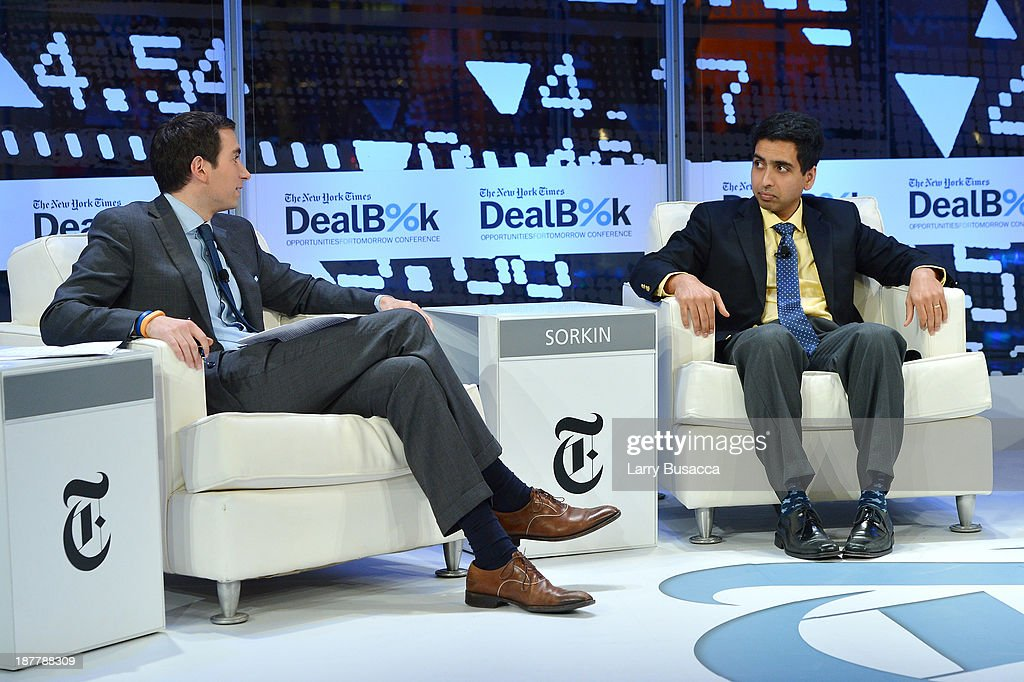 Journalist Andrew Ross Sorkin (L) and Founder of The Khan Academy Sal Khan participate in a discussion at the New York Times 2013 DealBook Conference in New York at the New York Times Building on November 12, 2013 in New York City.