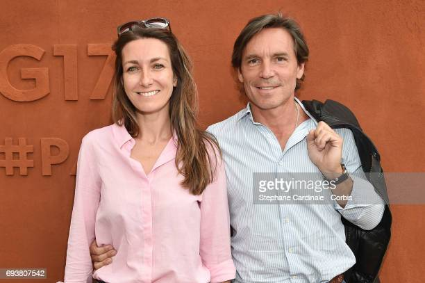 Journalist AnneClaire Coudray and her companion Nicolas Vix attend the French Tennis Open 2017 Day Twelve at Roland Garros on June 8 2017 in Paris...