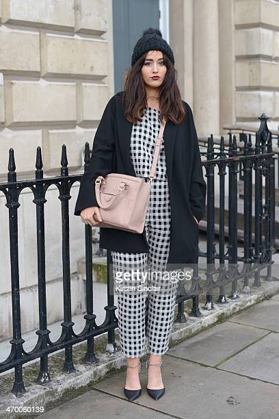 Journalist at British Mode Sophie Milner wears a Topshop hat trousers and top Mango jacket Zara bag Forever 21 shoes on day 2 of London Collections...