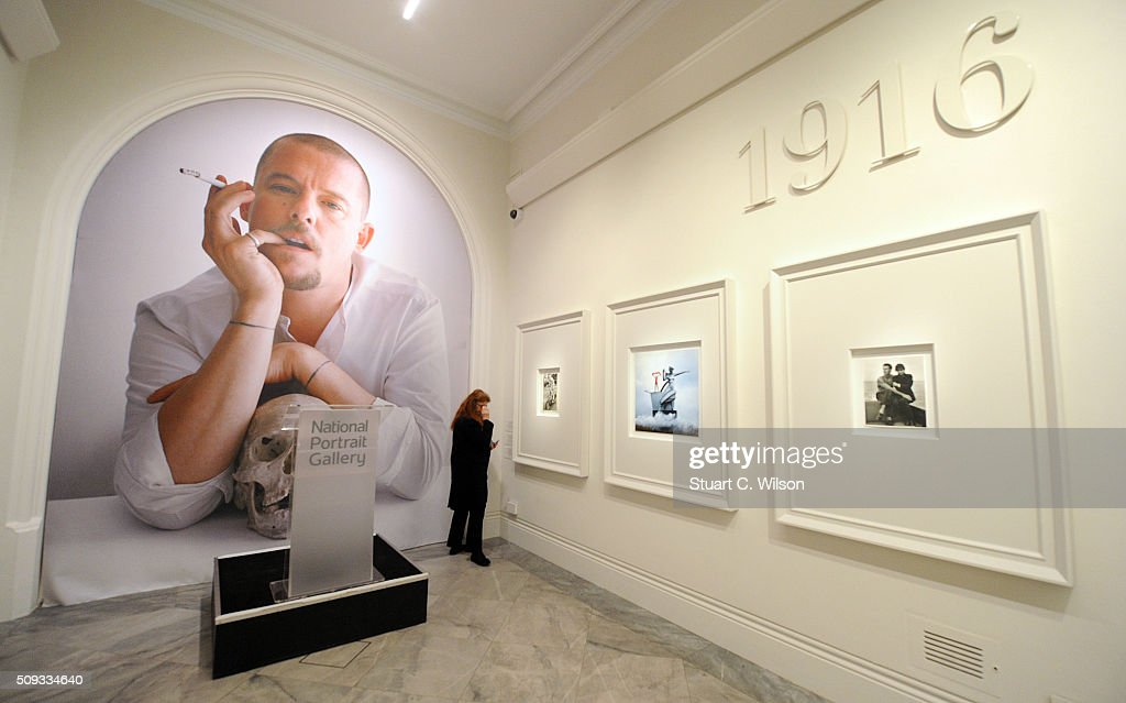 A journalist attends the press preview for 'Vogue 100: A Century of Style' exhibiting the photographs that has been commissioned by British Vogue since it was founded in 1916 at National Portrait Gallery on February 10, 2016 in London, England.