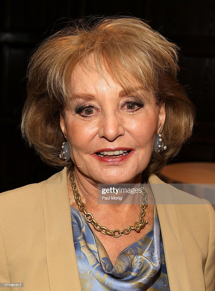 Journalist Barbara Walters arrives at the American News Women's Club 2013 Gala Award luncheon at The National Press Club on June 21, 2013 in Washington, DC.