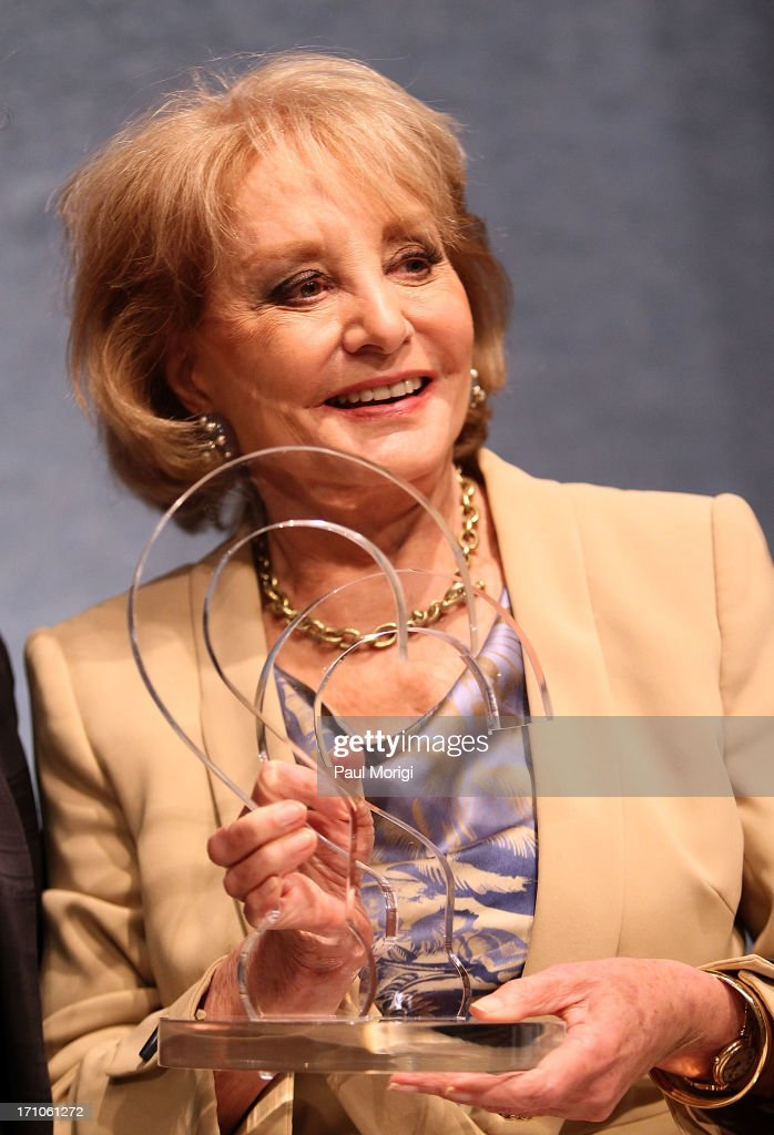 Journalist <a gi-track='captionPersonalityLinkClicked' href=/galleries/search?phrase=Barbara+Walters&family=editorial&specificpeople=201871 ng-click='$event.stopPropagation()'>Barbara Walters</a> receives the ANWC 'Excellence in Journalism Award' at the American News Women's Club 2013 Gala Award luncheon at The National Press Club on June 21, 2013 in Washington, DC.