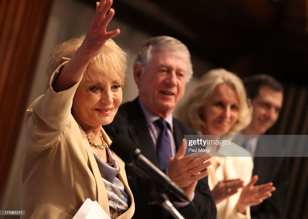 Journalist Barbara Walters waves to the audience after receiving the ANWC 'Excellence in Journalism Award' at the American News Women's Club 2013 Gala Award luncheon at The National Press Club on June 21, 2013 in Washington, DC.