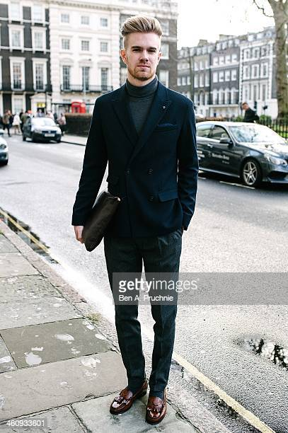 Journalist Billy poses wearing a Peyton Worth jacket topman trousers with a uniglo roll neck and HG loafers at the Matthew Miller catwalk...