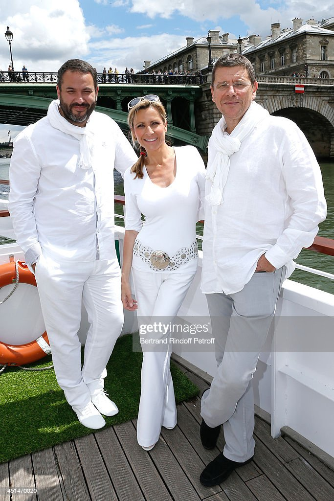 Journalist Bruce Toussaint, Marie-Laure Buisson and her husband Lawyer Gilles August attend the 'Brunch Blanc' hosted by Barriere Group. Held on Yacht 'Excellence' on June 29, 2014 in Paris, France.